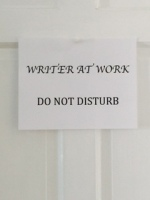 Writer at work sign