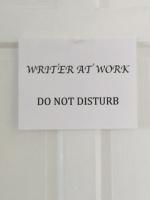 Writer at work sign